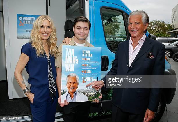 Actress Alana Stewart George Thomas Hamilton and actor George Hamilton pose for a photo as E sends the Tan Man's Van off in style at the Farmers...