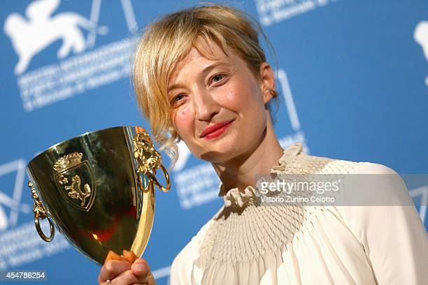 Actress Alba Rohrwacher poses with her Best Actress award for Hungry Hearts during the award winners photocall of the 71st Venice Film Festival on...
