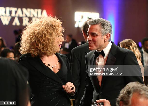 Actress Alex Kingston and filmmaker George Clooney attend the 2013 BAFTA LA Jaguar Britannia Awards presented by BBC America at The Beverly Hilton...
