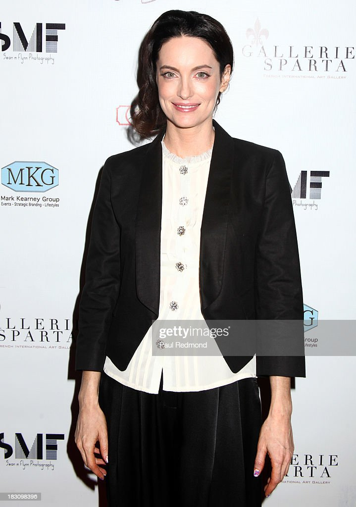 Actress Alex Lombard attends Jane Seymour Art Exhibition Opening Benefiting Open Hearts Foundation at Gallerie Sparta on October 3, 2013 in West Hollywood, California.