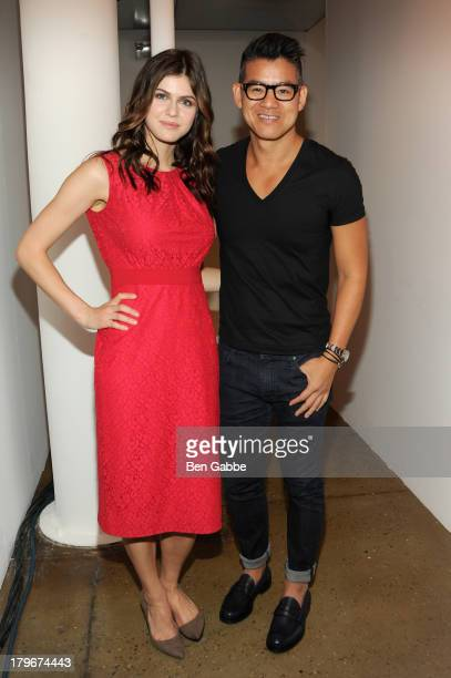 Actress Alexandra Daddario and designer Peter Som pose backstage at the Peter Som Spring 2014 fashion show during MercedesBenz Fashion Week at Milk...