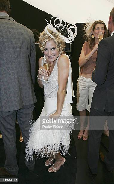 Actress Alexandra Davies attends the Melbourne Cup Carnival's Derby Day in the Moet et Chandon marquee at Flemington October 30 2004 in Sydney...