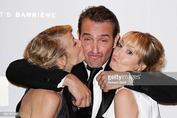 Actress Alexandra Lamy actor Jean Dujardin and Audrey Lamy attend the 37th Cesar Film Awards at Le Fouquet's on February 24 2012 in Paris France