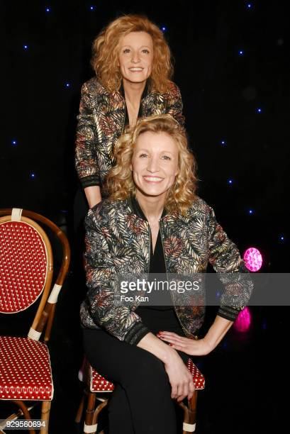 Actress Alexandra Lamy poses with her wax statue during Alexandra Lamy waxwork unveiling at Musee Grevin on March 8 2018 in Paris France