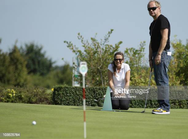 Actress Alexandra Neldel and actor Uwe Ochsenknecht attend the BMW Adlon Golf Cup 2010 at Golf and Country Club Seddiner See on August 21 2010 in...