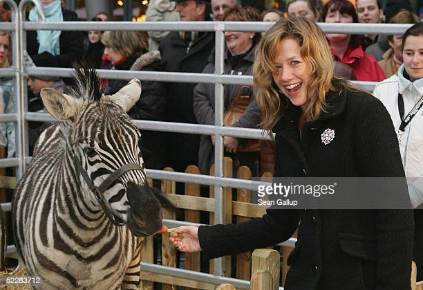 """Actress Alexandra Neldel poses with a zebra at the German premiere of """"Racing Stripes"""" on March 6, 2005 in Berlin, Germany."""