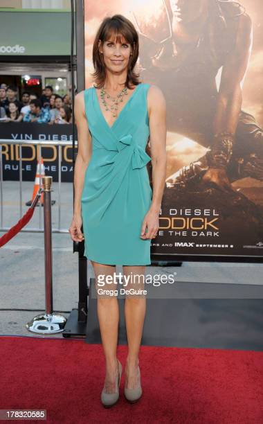 Actress Alexandra Paul arrives at the Los Angeles premiere of Riddick at the Westwood Village Theatre on August 28 2013 in Westwood California
