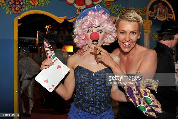 Actress Alexandra Rietz and a clown pose during the P1 Summerparty at P1 on July 12 2011 in Munich Germany