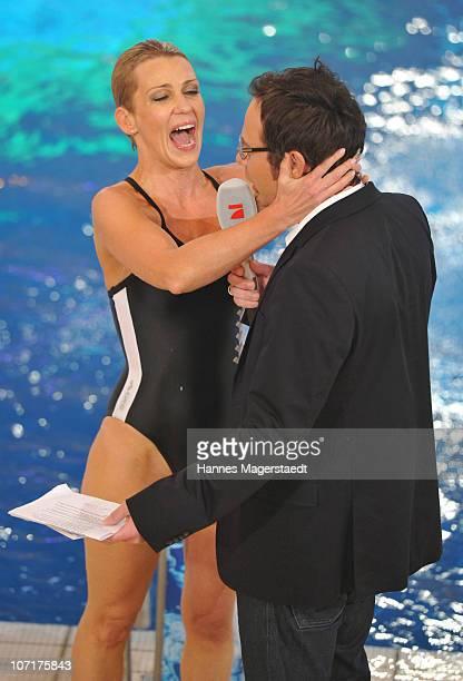Actress Alexandra Rietz embraces TV host Matthias Opdenhoevel after diving during the TV Total Turmspringen - TV Show at the Munich...