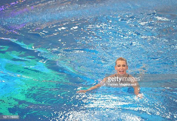 Actress Alexandra Rietz swims during the TV Total Turmspringen TV Show at the Munich Olympiaschwimmhalle on November 27 2010 in Munich Germany
