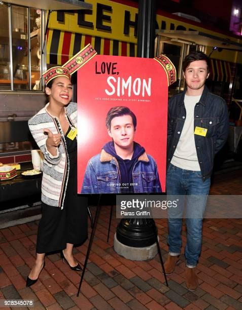 "Actress Alexandra Shipp and actor Nick Robinson attend ""Love, Simon"" Atlanta Fan Screening and Q&A at the Waffle House Food Truck at Regal Atlantic..."