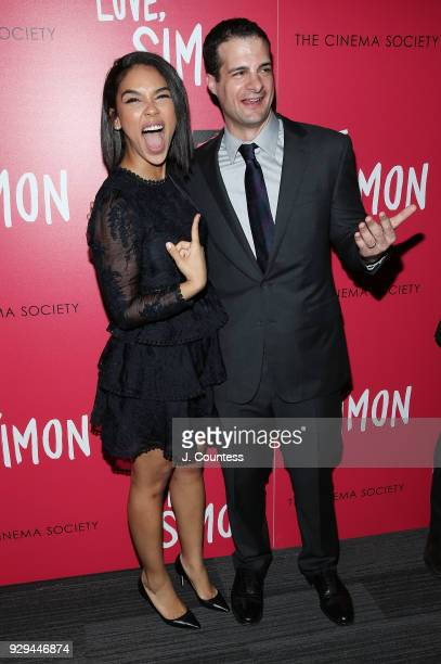 Actress Alexandra Shipp and producer Pouya Shahbazian pose for a photo at the screening of 'Love Simon' hosted by 20th Century Fox Wingman at The...