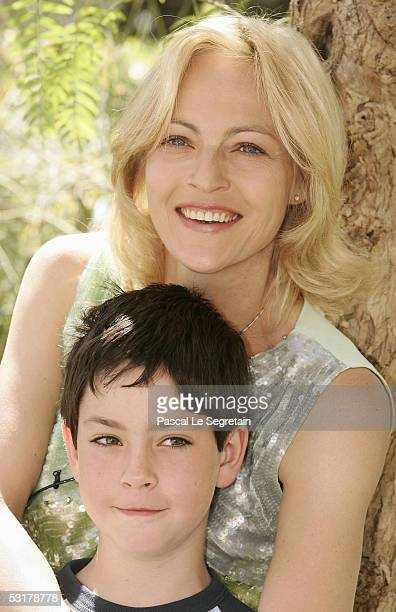 """Actress Alexandra Vandernoot from """"Carla Rubens"""" TV show poses with her son, Leo Uzan, during a photo call at the 45th Television Festival of Monte..."""