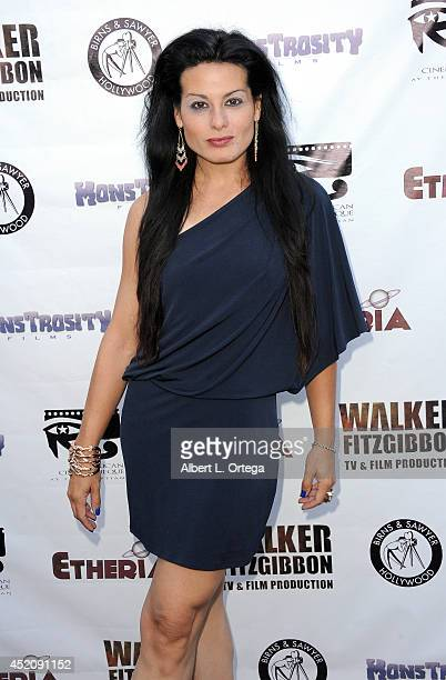 Actress Alexis Iacono arrives for the 2014 Etheria Film Night held at American Cinematheque's Egyptian Theatre on July 12 2014 in Hollywood California