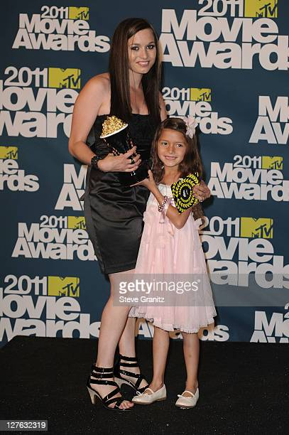 Actress Alexys Nycole Sanchez and guest pose in the press room during the 2011 MTV Movie Awards at Universal Studios' Gibson Amphitheatre on June 5...