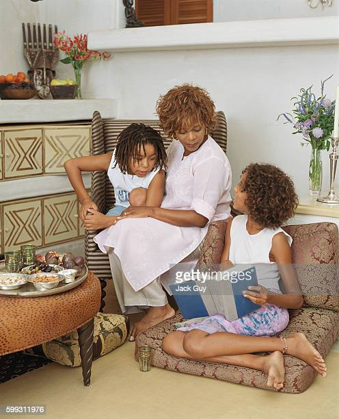Actress Alfre Woodard is photographed with her children Duncan and Mavis for InStyle Magazine in 2003 at home in Santa Monica California PUBLISHED...