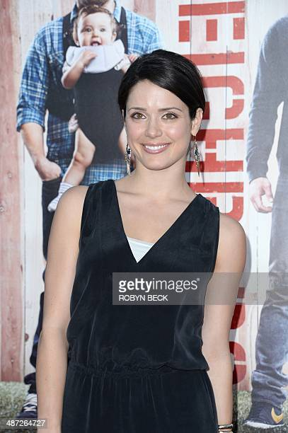 Actress Ali Cobrin arrives for the world premiere of 'Neighbors' April 28 2014 at the Regency Village Theater in Los Angeles California Man at right...