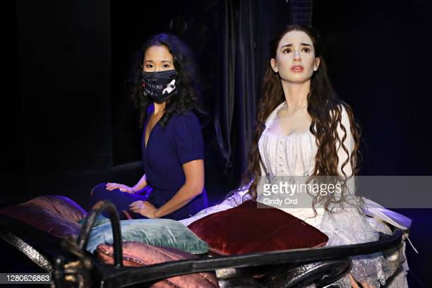Actress Ali Ewoldt poses for a photo with a figure of Christine Daaé from 'The Phantom of the Opera' while touring 'Madame Tussauds New York Presents...