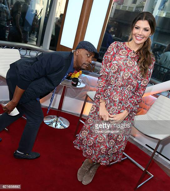Actress Ali Landry is photobombed by comedian Arsenio Hall at Hollywood Today Live at W Hollywood on November 7 2016 in Hollywood California