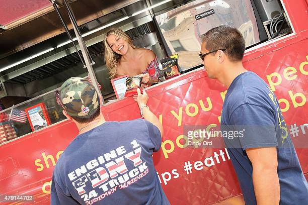 Actress Ali Larter attends the popchips Crazy Hot BBQ hosted by Ali Larter for the FDNY at Flatiron Plaza on July 1 2015 in New York City