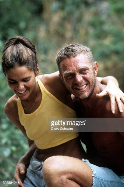 Actress Ali MacGraw and actor Steve McQueen on a break during the filming of Papillon in which McQueen stars on location in Jamaica