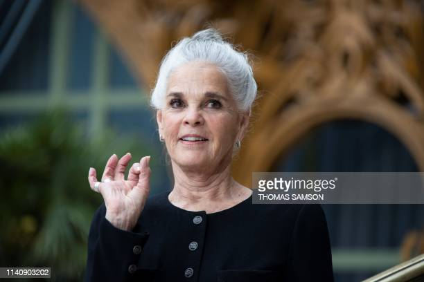 US actress Ali MacGraw poses during the photocall prior to the 2020 Chanel Croisiere fashion show at the Grand Palais in Paris on May 3 2019