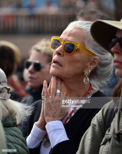 Actress Ali Macgraw reacts to an emotional address by a high school student at a 'March For Our Lives' rally in Santa Fe, New Mexico. The rally and...