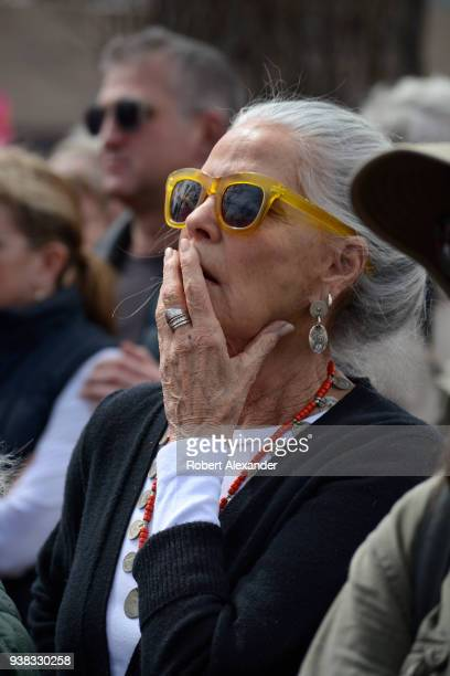 Actress Ali Macgraw reacts to an emotional address by a high school student at a 'March For Our Lives' rally in Santa Fe New Mexico The rally and...