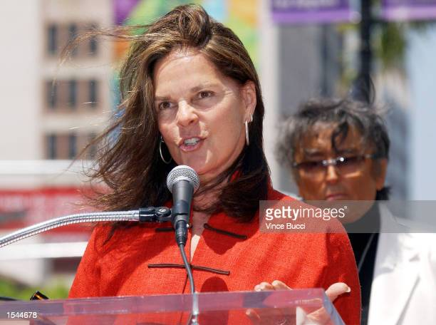 Actress Ali MacGraw speaks at a ceremony honoring producer Robert Evans with a star on the Hollywood Walk of Fame May 23 2002 in Hollywood CA