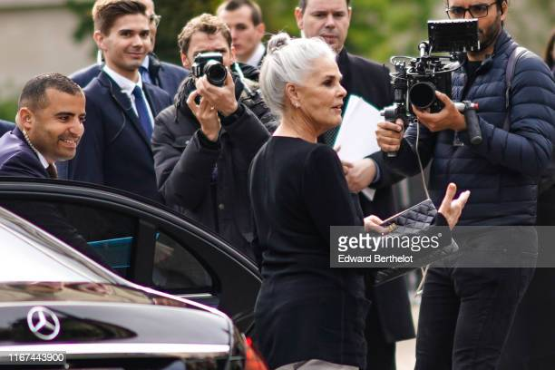 Actress Ali MacGraw wears a black top a black Chanel bag outside the Chanel Cruise Collection 2020 At Grand Palais on May 03 2019 in Paris France
