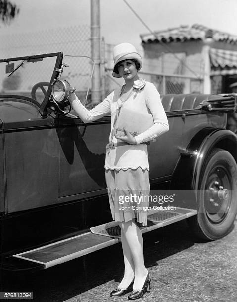 Actress Alice Adair Standing with Automobile