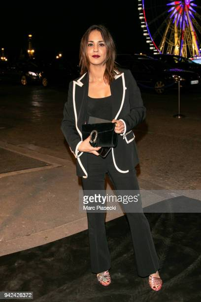 Actress Alice Belaidi arrives to attend the 'Madame Figaro' dinner at Automobile Club de France on April 5 2018 in Paris France