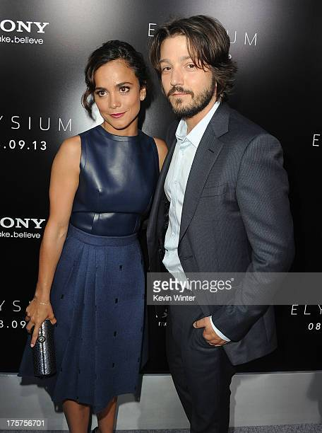Actress Alice Braga and actor Diego Luna attend the premiere of TriStar Pictures' Elysium at Regency Village Theatre on August 7 2013 in Westwood...
