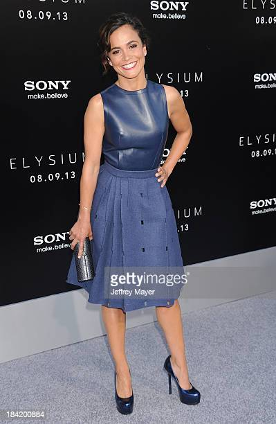 Actress Alice Braga arrives at the Los Angeles premiere of 'Elysium' at Regency Village Theatre on August 7 2013 in Westwood California