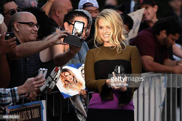 Actress Alice Eve poses for selfies with fans and signs autographs during the premiere of Radius and G4 Productions' Before We Go at ArcLight Cinemas...