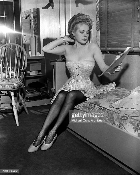 Actress Alice Faye gets ready in her dressing room to film the 20th Century Fox movie Lillian Russell in Los Angeles California