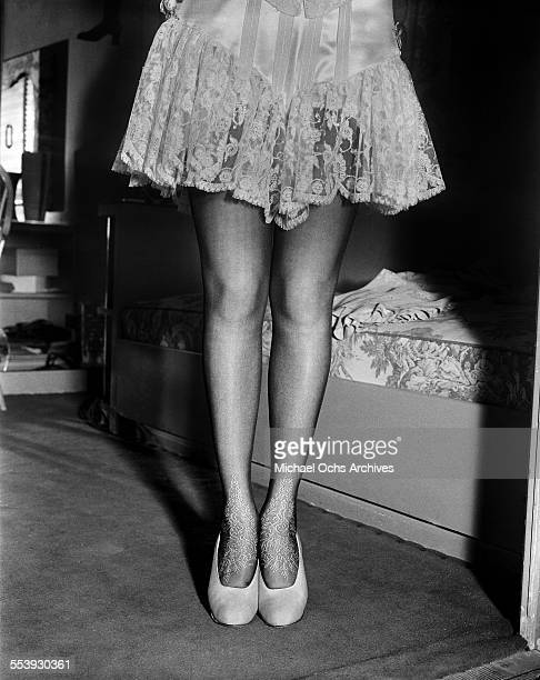 Actress Alice Faye legs and detailed stockings are photographed as she gets ready to film Lillian Russell in Los Angeles California