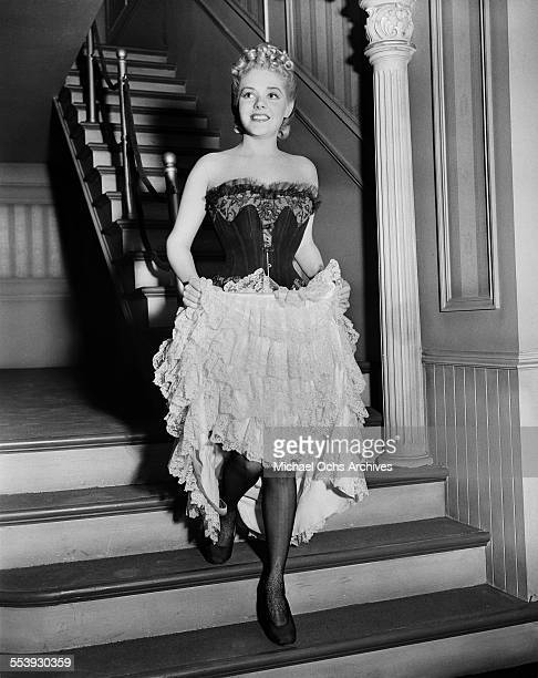 Actress Alice Faye walks down stairs as she is ready to film Lillian Russell in Los Angeles California
