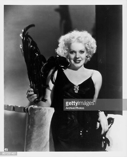 Actress Alice Faye wearing an evening dress with feathered plume as she appears in the movie 'Now I'll Tell' 1934