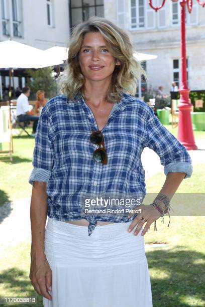Actress Alice Taglioni attends the Photocall of the movie Je voudrais que quelqu'un m'attende quelque part during the 12th Angouleme FrenchSpeaking...