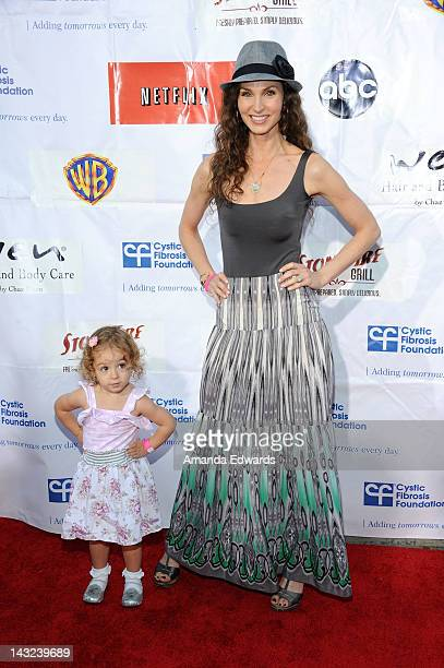 Actress Alicia Minshew and her daughter Willow Herschenfeld arrive at the Band From TV's 2nd Annual Block Party On Wisteria Lane at Universal Studios...
