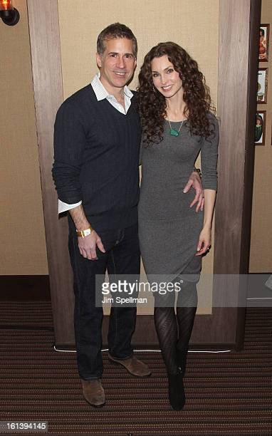 Actress Alicia Minshew and husband attend the Spontaneous Construction premiere at Guys American Kitchen Bar on February 10 2013 in New York City