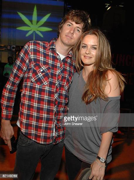 Actress Alicia Silverston and Christopher Jarecki attend the after party for Columbia Pictures 'Pineapple Express' at Mann Village Theater on July 31...