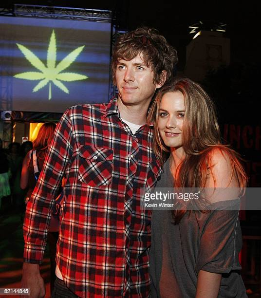 Actress Alicia Silverstone and husband Christopher Jarecki pose at the afterparty for the premiere of Columbia Picture's 'Pineapple Express' at the...