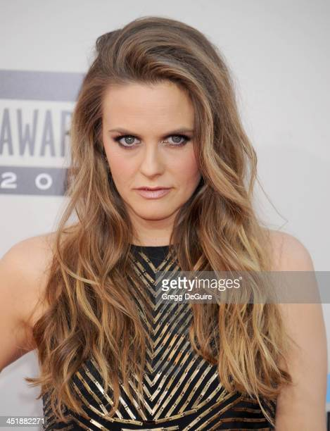 Actress Alicia Silverstone arrives at the 2013 American Music Awards at Nokia Theatre LA Live on November 24 2013 in Los Angeles California