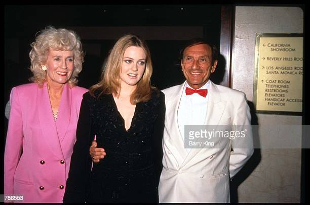 Actress Alicia Silverstone stands with her parents Didi and Monty at the Genesis Awards April 5 1997 in Los Angeles CA The Genesis Award is presented...