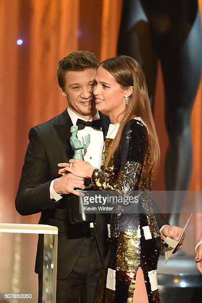 Actress Alicia Vikander accepts the Female Actor in a Supporting Role award for 'The Danish Girl' from actor Jeremy Renner onstage during The 22nd...
