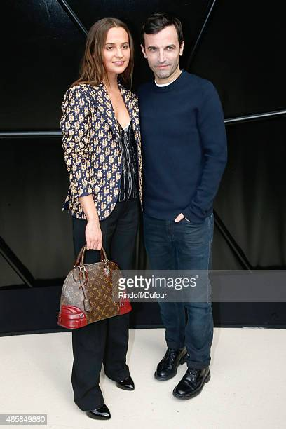 Actress Alicia Vikander and Fashion Designer Nicolas Ghesquiere pose after the Louis Vuitton show as part of the Paris Fashion Week Womenswear...