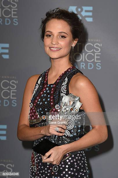 """Actress Alicia Vikander, winner of the award for Best Supporting Actress for """"The Danish Girl,"""" poses in the press room during the 21st Annual..."""