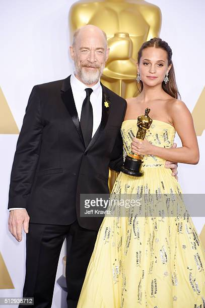 Actress Alicia Vikander winner of the Best Actress in a Supporting Role award for 'The Danish Girl' poses with actor JK Simmons in the press room...